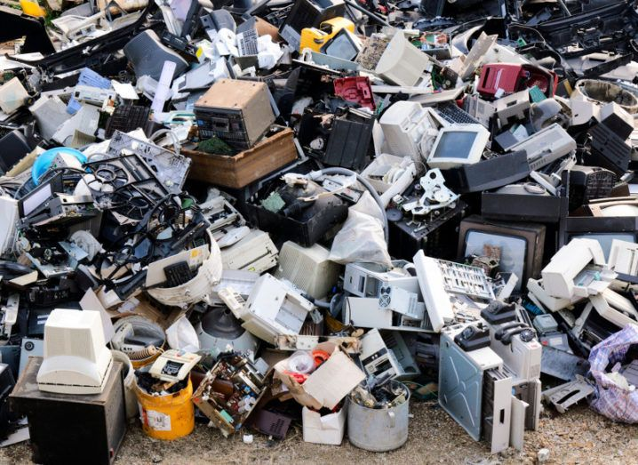 A large pile of e-waste including computers, monitors, TV sets, games consoles and telephones.