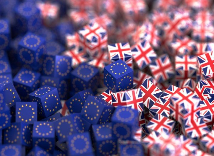 3D render of cubes covered in EU flags and UK flags colliding.