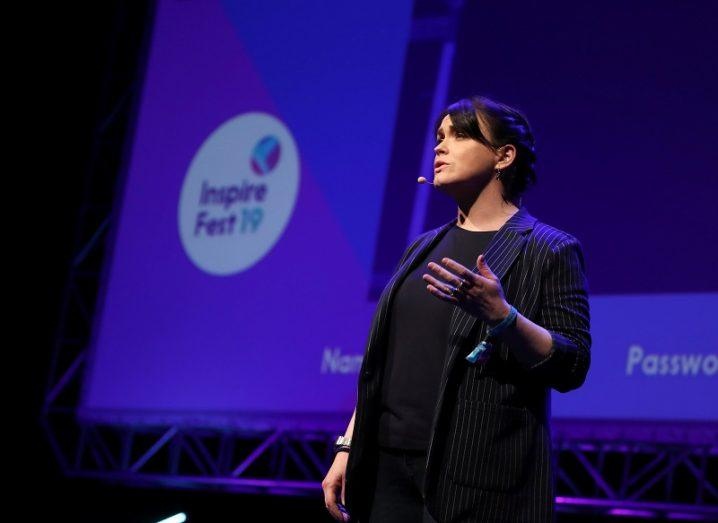 Debbie O'Reilly in a black cardigan and T-shirt on stage at Inspirefest 2019.
