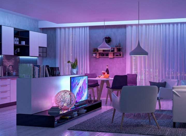 Living room filled with smart devices lit up with purple LED light.