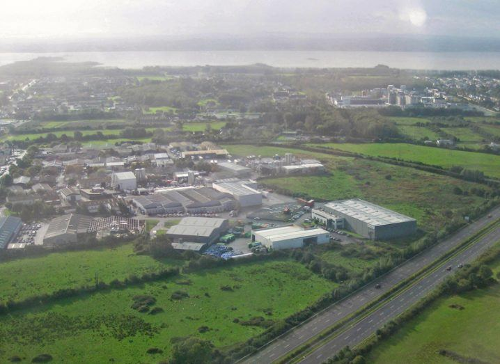 Aerial view of Shannon town looking southwest towards the river banks, with the industrial estate to the left and residential area to the right.