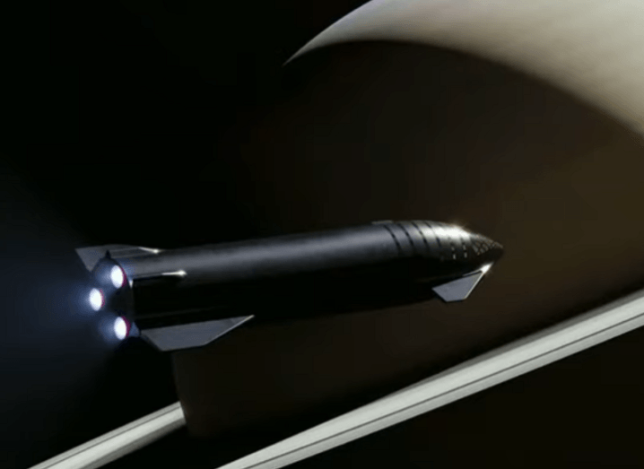 Concept of SpaceX's Starship travelling past Saturn.