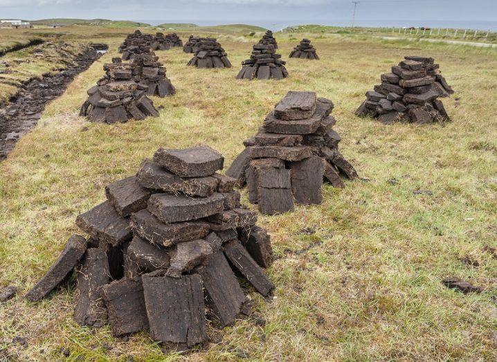 Turf piles beside an Irish bog.