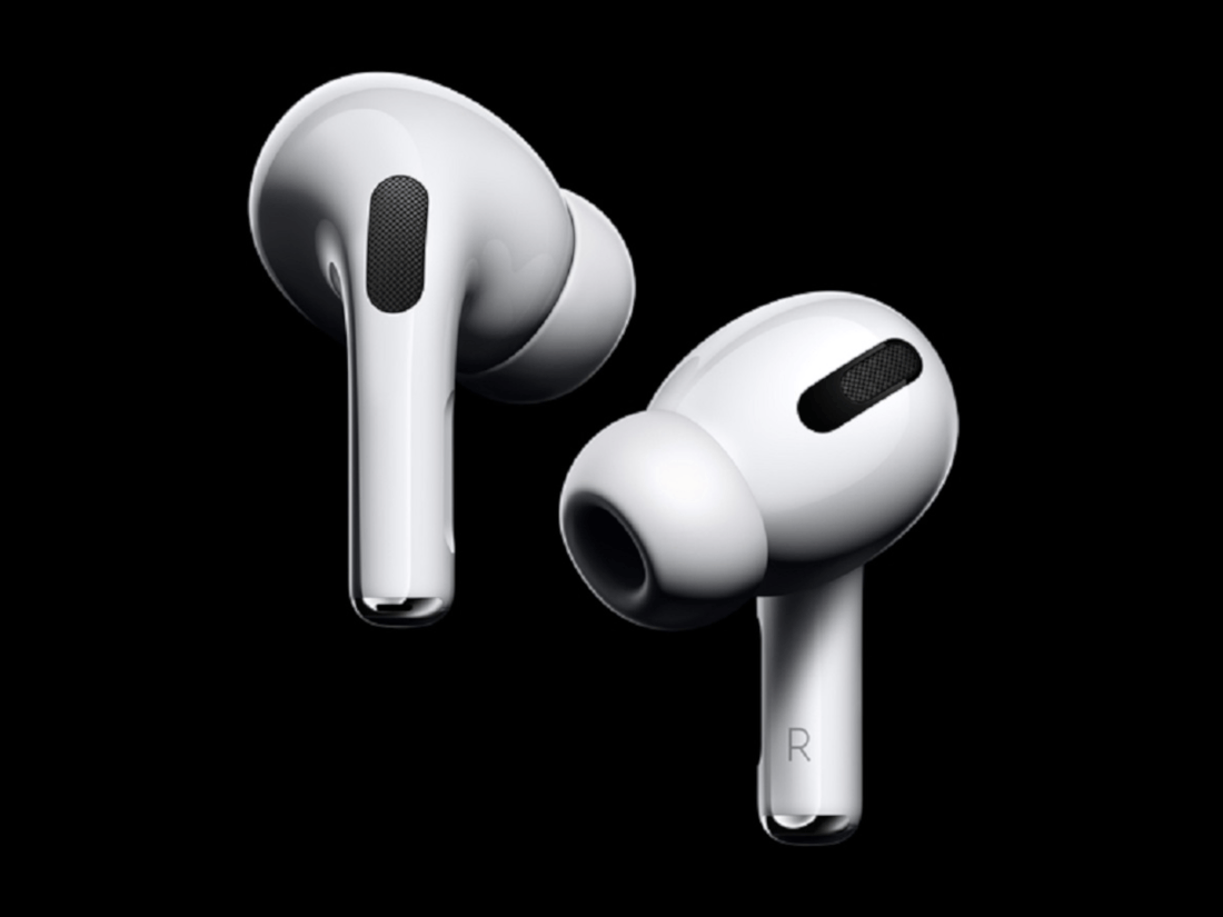 Two white earphones in front of a black background.