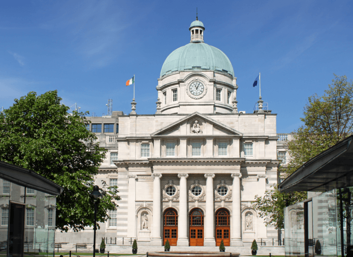 Leinster House, a large white building with a green dome on top of it.