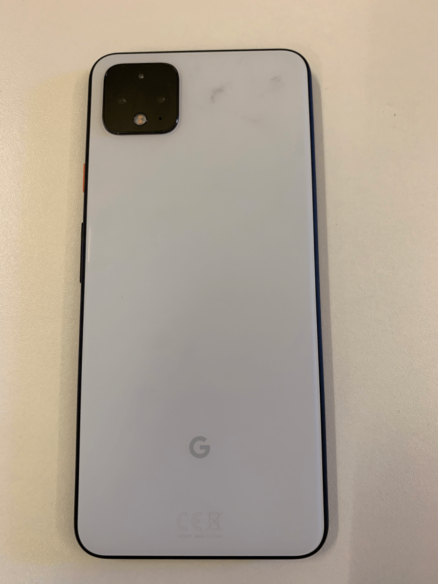 The back of the Pixel 4 XL, which is white. It has a black mark beside the camera.