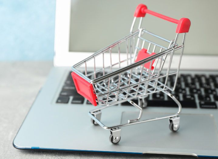 Small shopping cart on a laptop on a desk.
