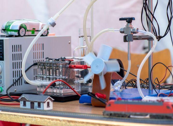 Lab desk full of hydrogen fuel experiment equipment.