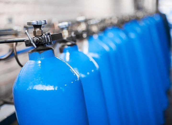 Line of blue tanks containing liquid hydrogen.