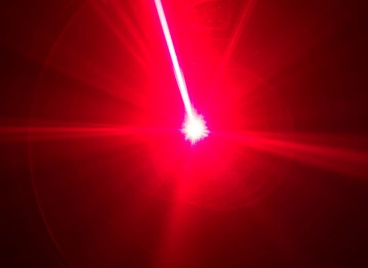 Red laser beam against a black background.