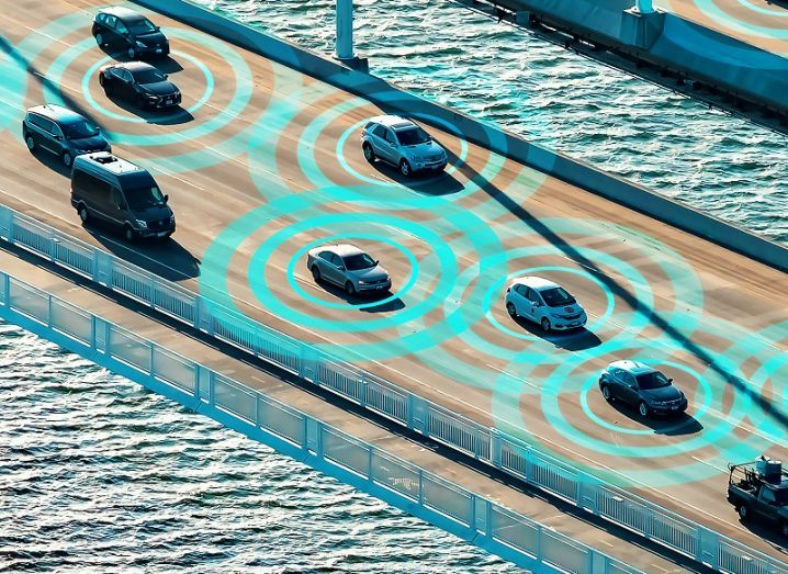Concept shot of autonomous cars on a bridge communicating with one another.