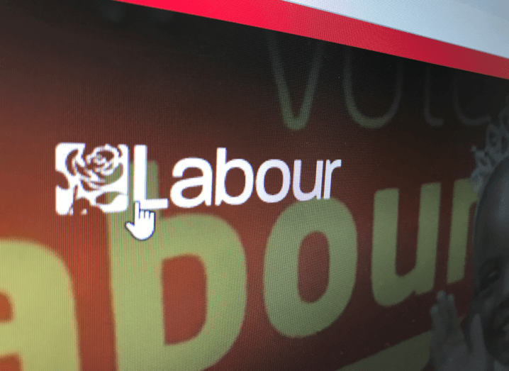 The homepage of the UK Labour Party's website. It is red with the white Labour Party logo depicting a rose.