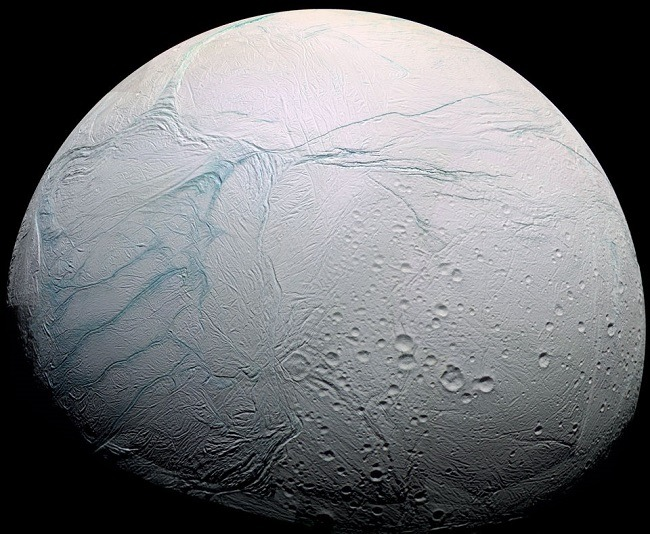 Orbital image of Enceladus with 'tiger stripe' fissures on its surface.
