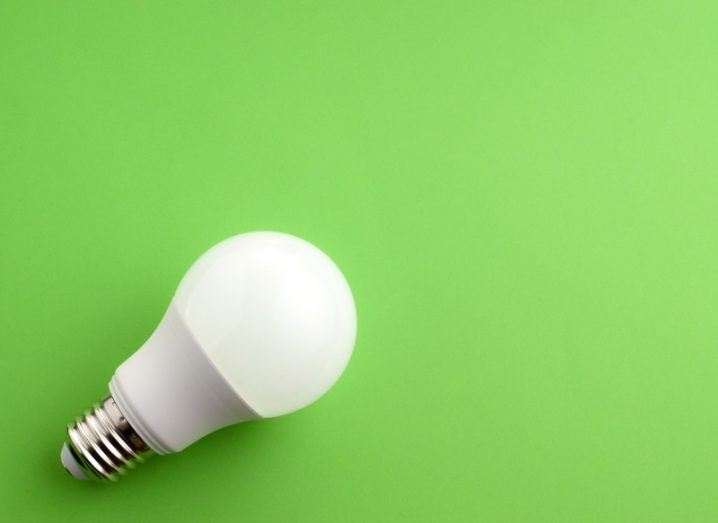 A lightbulb against a bright green background.