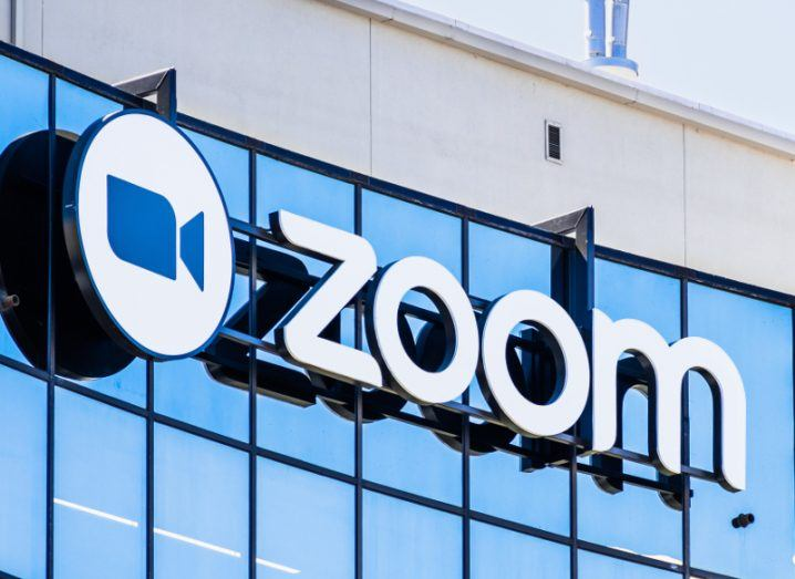 View of Zoom video conferencing company logo on glass building at the company HQ.