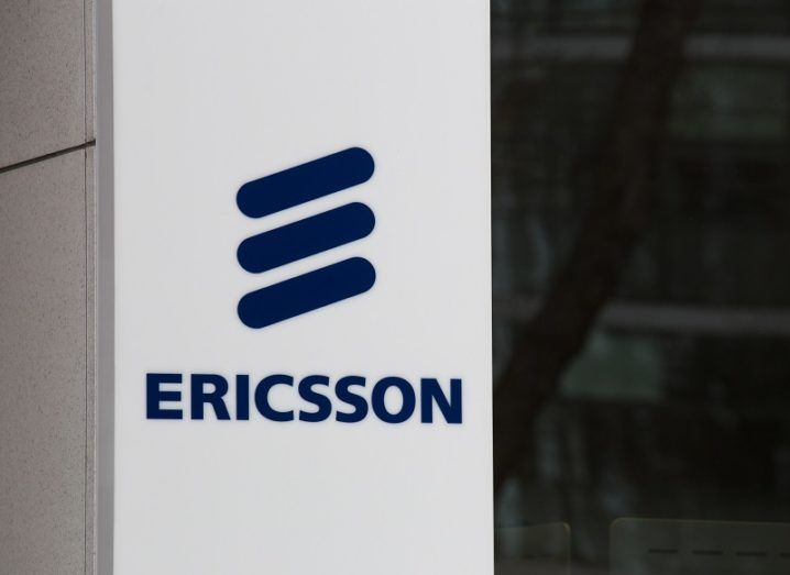 Blue Ericsson logo on a white pillar.