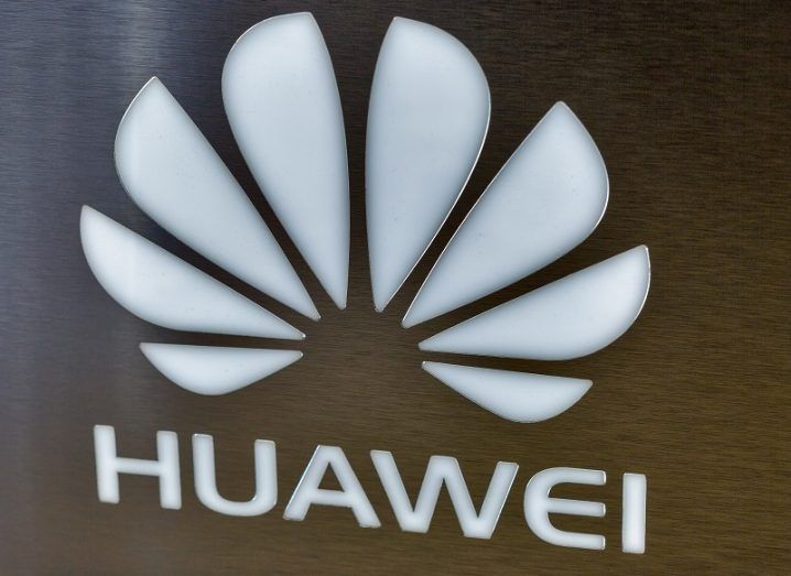 Huawei lotus-shaped logo and name against a brown background.