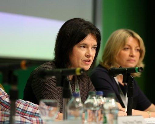 Dr Áine Ryall speaking from a table as a member of the Citizens' Assembly.