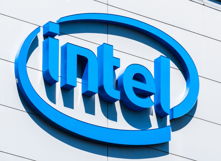 The blue Intel logo on the outside of a grey building.