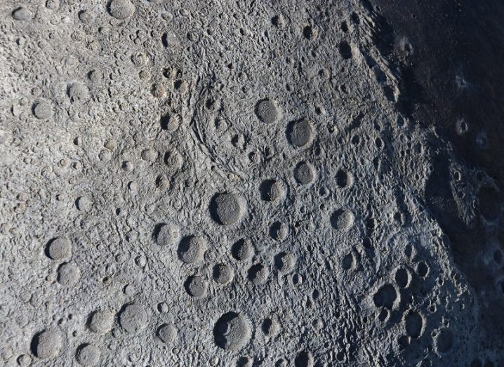 Surface of the moon covered in craters.