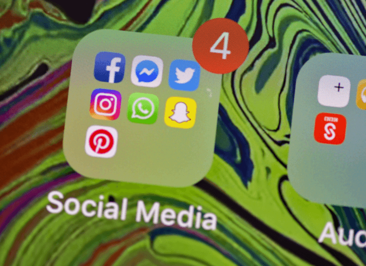 An iPhone screen displaying the icons for Facebook, Twitter, Instagram, WhatsApp, Pinterest and Snapchat. These are platforms where so-called junk news is often shared.