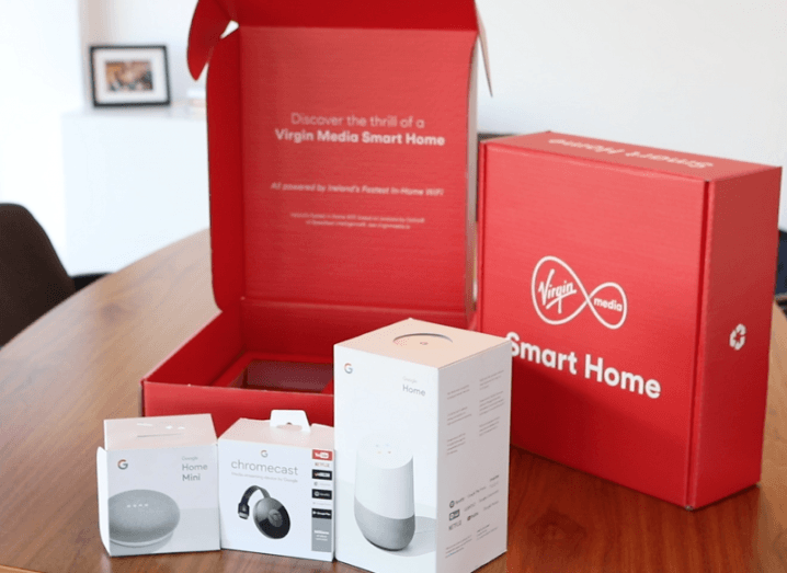 Virgin Media smart home package including Google devices on a wooden table in an office.