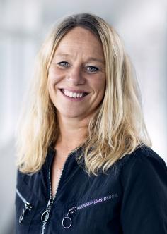 Headshot of Kristine van het Erve Grunnet in a dark navy top.