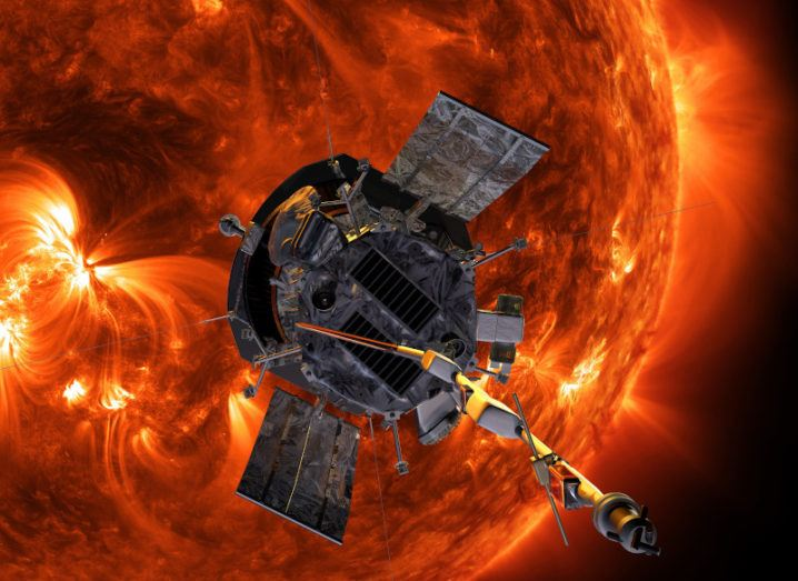 An artist's impression of the Parker Solar Probe spacecraft approaching the red, fiery sun.