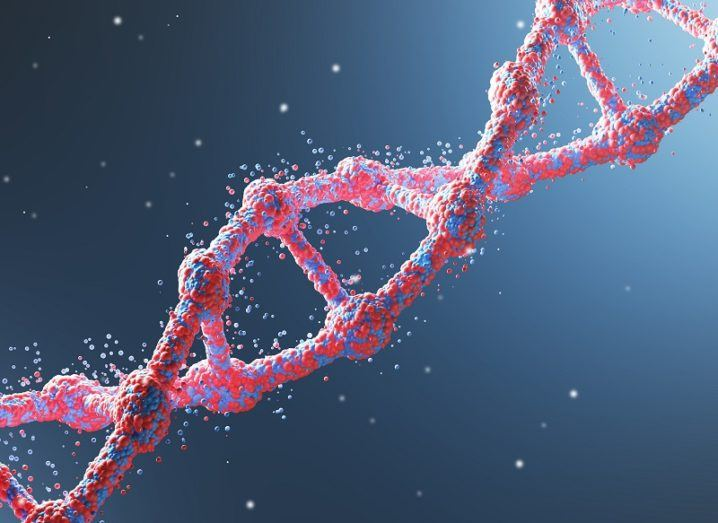 Close up of a red diagonal DNA chain against dark blue background.