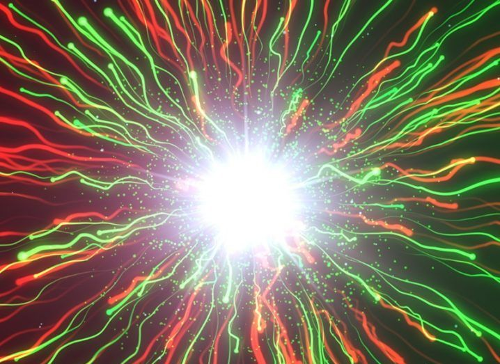Illustration of green and red luminous lines emitting from a bright, white sphere representing nuclear fusion.