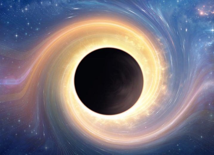 Concept image of a black hole sucking in a yellow particle stream.