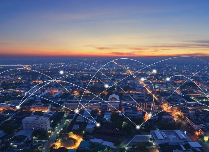Aerial view of a city with rendered, interconnected points representing 5G.