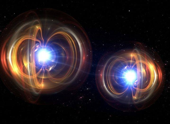 Illustration of two quantum particles coloured orange and blue against a black background.