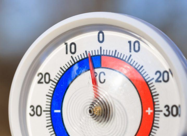 Close-up of a temperature gauge coloured in blue and red, with the dial edging into the colder blue side.