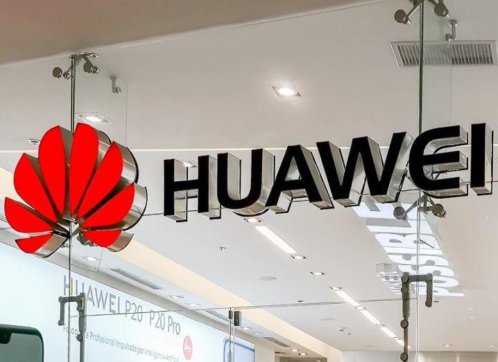 Huawei logo on a glass wall.