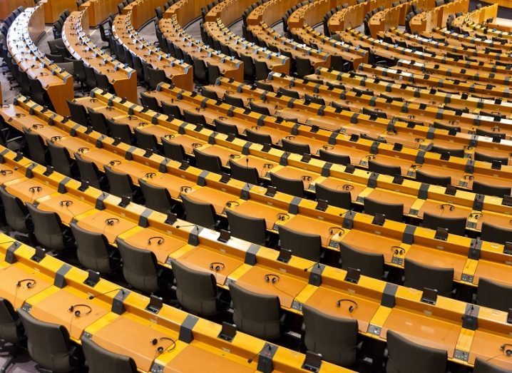 Top-down view of empty seats at the European Parliament.