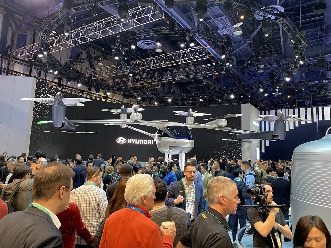 Hyundai's Uber Air concept on display surrounded by a large crowd at CES.