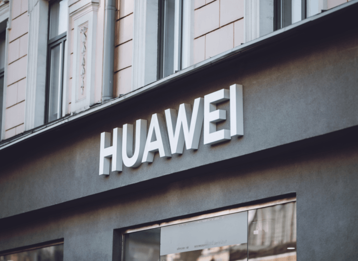 The Huawei logo displayed on the front of a shop.