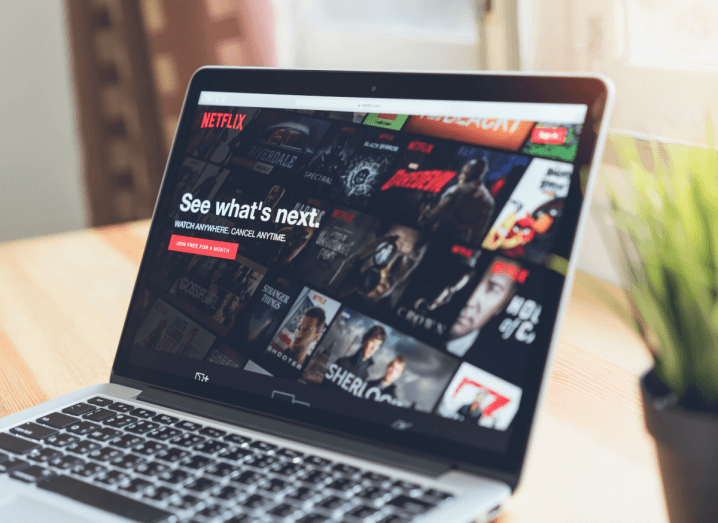 A laptop screen displaying the Netflix login page.