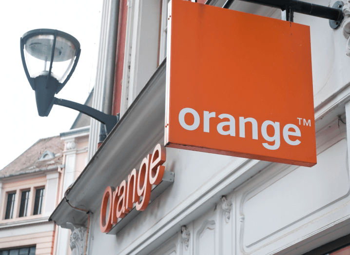 The Orange logo on an ornate white building.