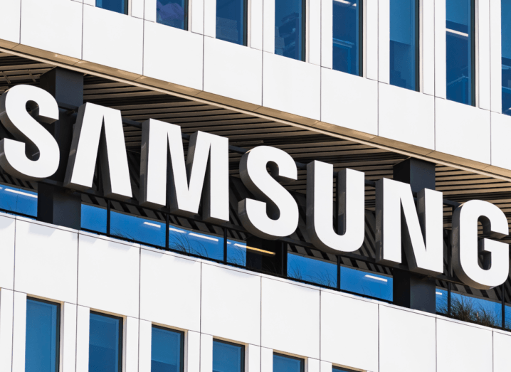 The front of an office block with the Samsung logo displayed.