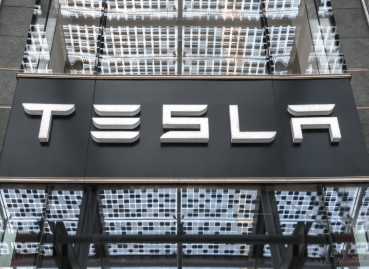 The Tesla logo displayed on the front of a building.