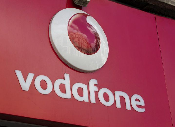 Vodafone logo on a storefront.