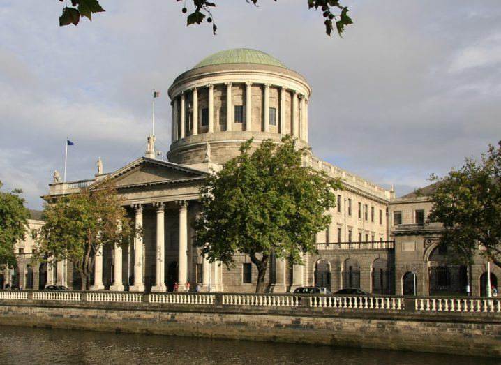 The Four Courts in Dublin against a grey sky.