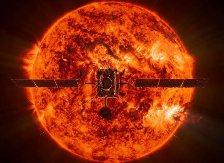 Illustration of Solar Orbiter with the sun looming large behind it.