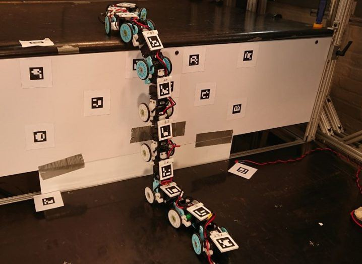 The modular snake robot climbing a steep, white surface with ease.