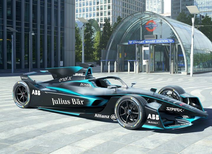 Side profile of the Gen2 EVO Formula E car coloured black against a city street background.
