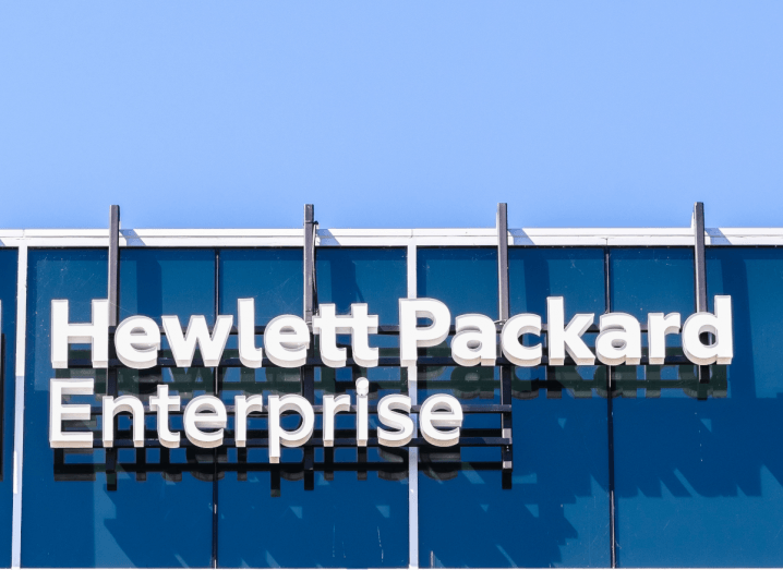 The Hewlett Packard Enterprise logo on the front of a building in Silicon Valley, under a blue sky.