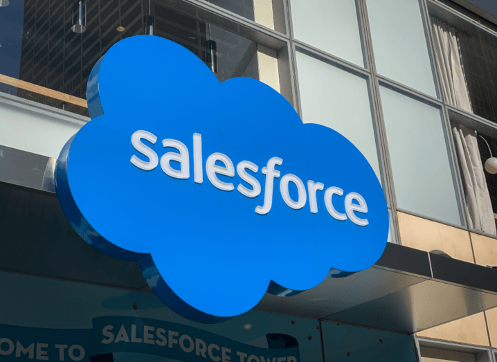 The Salesforce logo on the outside of a Salesforce office building.