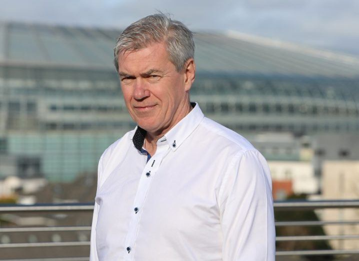 Mark Foley in a white shirt against a rooftop background that includes the Aviva Stadium.